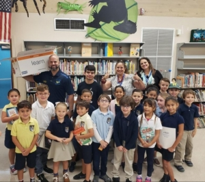 Blue Lakes receives books from MDCPS library services
